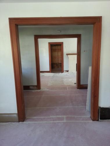 First floor primed. Original woodwork.