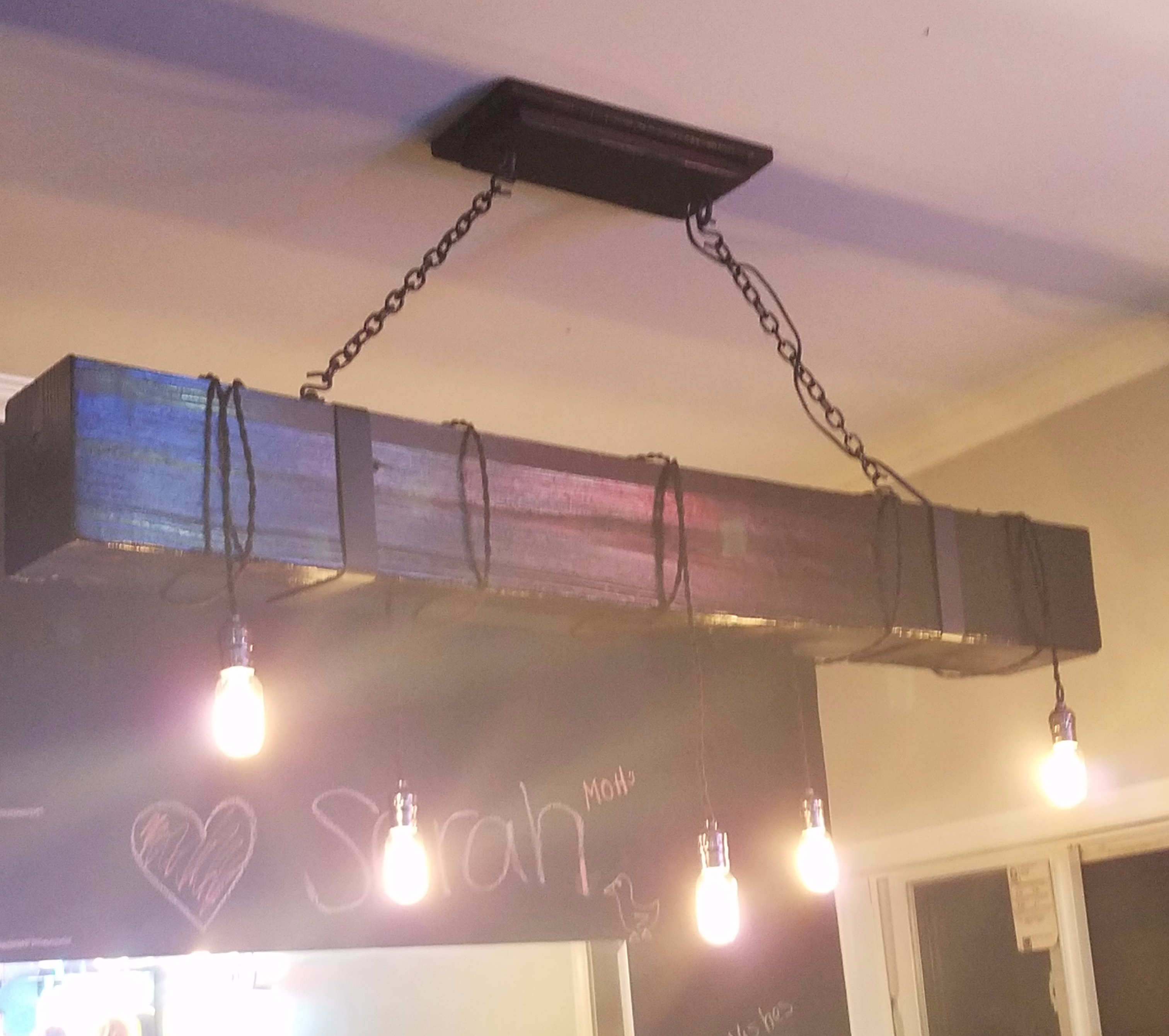 The new light fixture would be less bulky and more industrial looking. Keeping the concept of the rope lights and edison bulbs they would now hang on black ... & A girl walks into a baru2026
